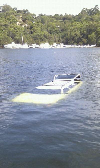 Car afloat at Roseville boat ramp